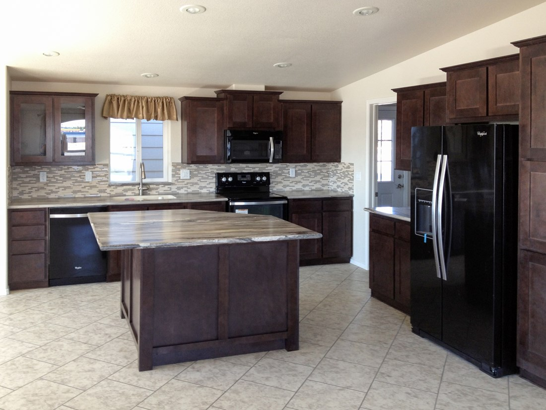 The 9587S THE JEFFERSON Kitchen. This Manufactured Mobile Home features 2 bedrooms and 2 baths.