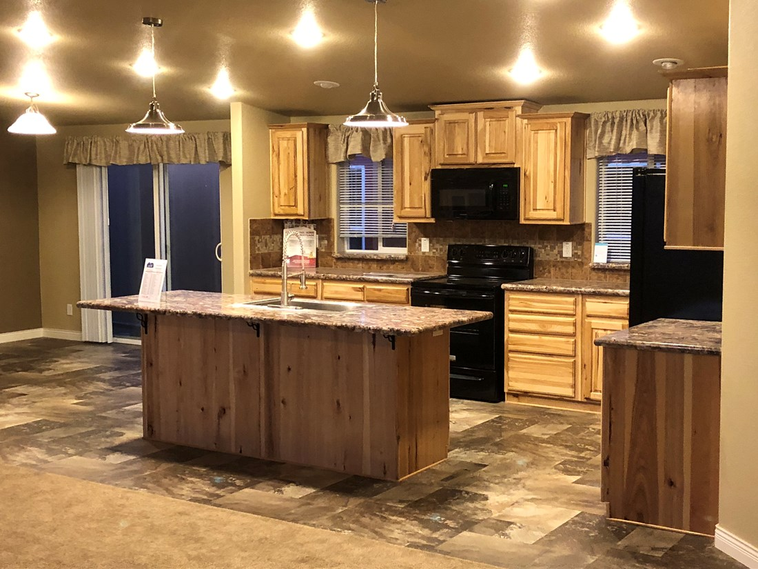 The 9588S THE SAINT HELENS Kitchen. This Manufactured Mobile Home features 3 bedrooms and 2 baths.