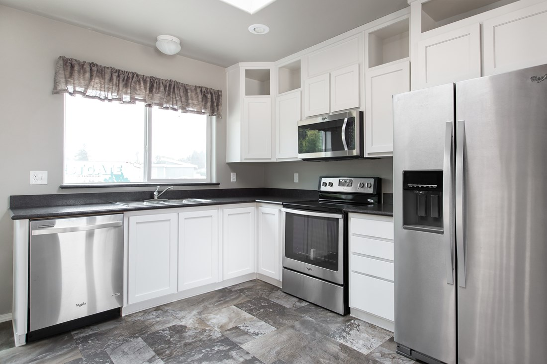 The 2844A DESERT BLOOM Kitchen. This Manufactured Mobile Home features 3 bedrooms and 2 baths.