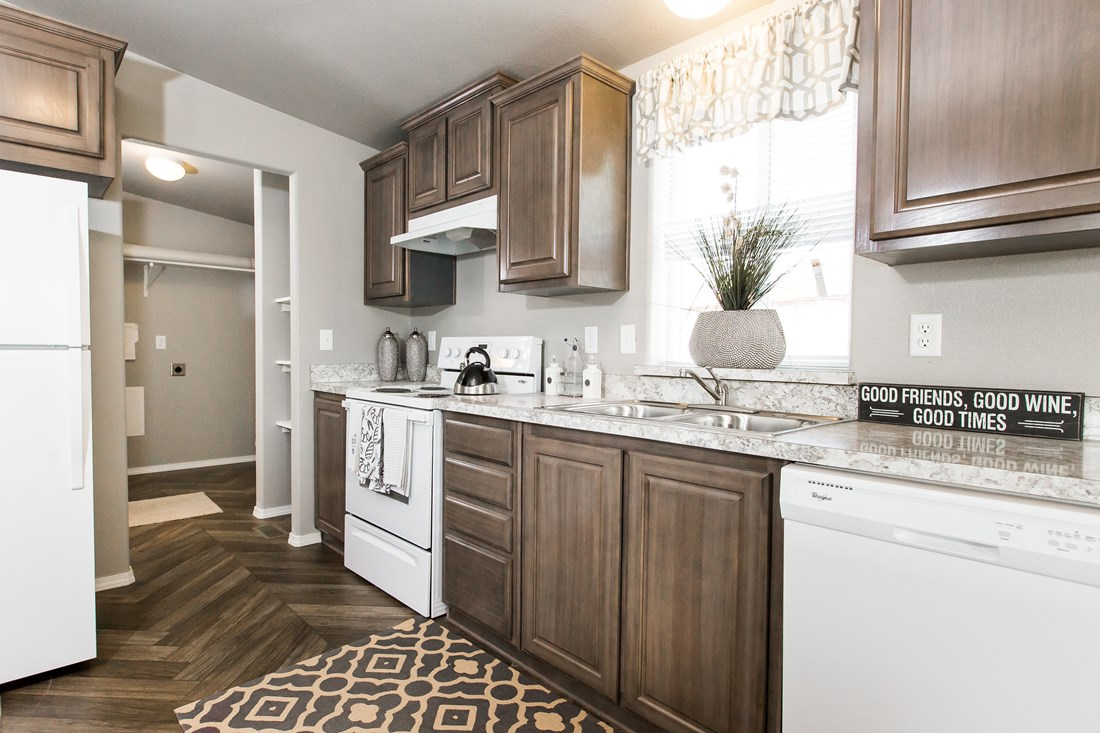 The 2848A MOUNTAIN LEDGE Kitchen. This Manufactured Mobile Home features 3 bedrooms and 2 baths.
